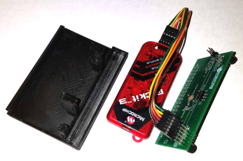Card holder programmer in pieces